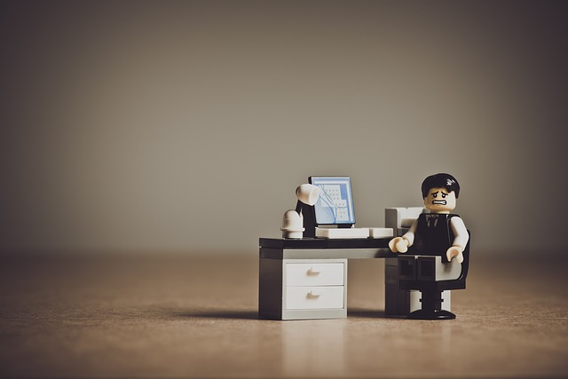 Picture of a busy person on a computer (Lego).